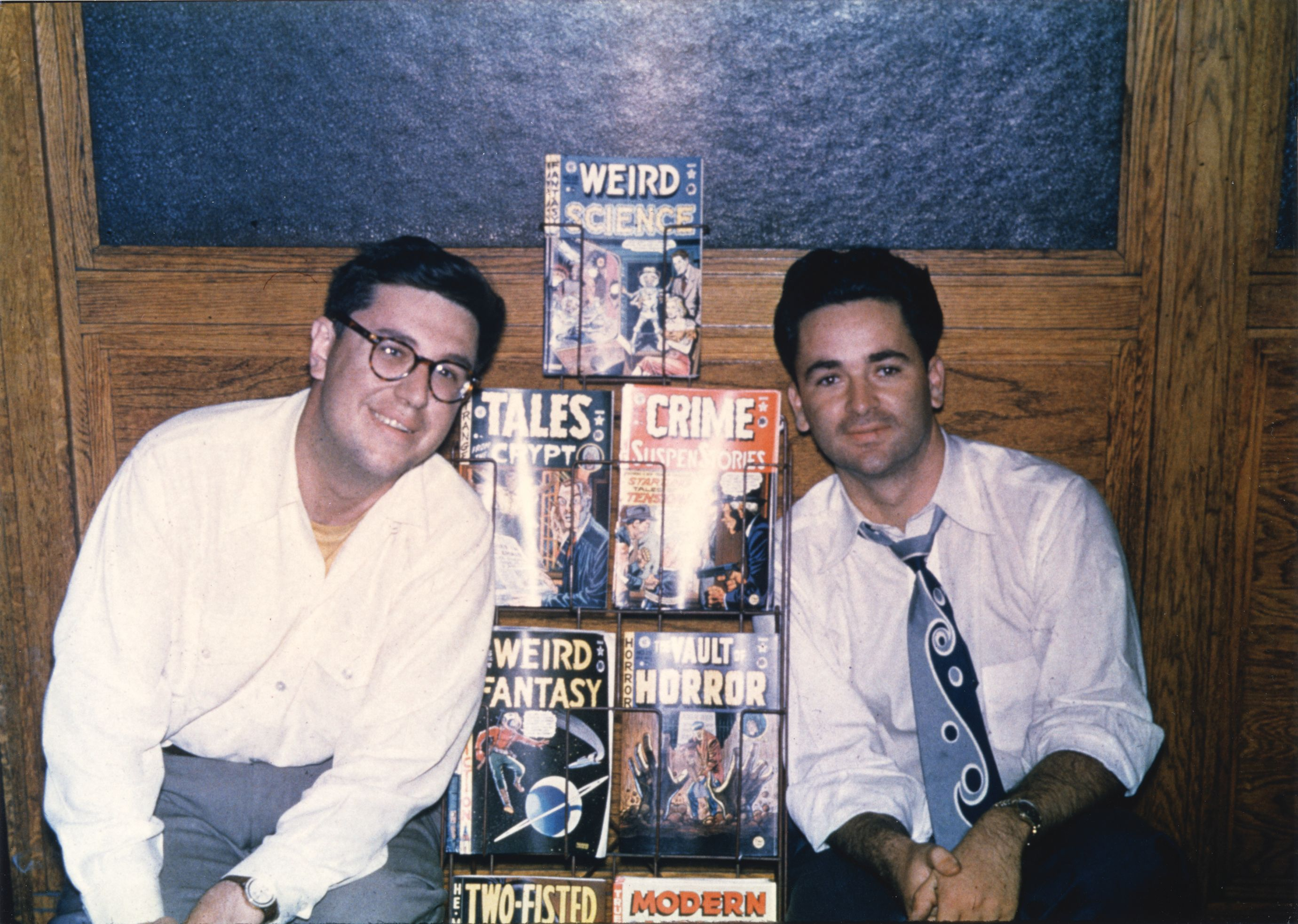 Bill Gaines and Al Feldstein with a rack of EC comics in 1950.